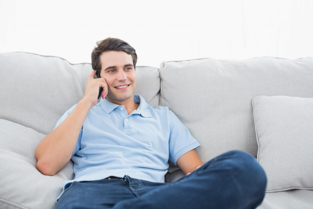 man with his phone calls